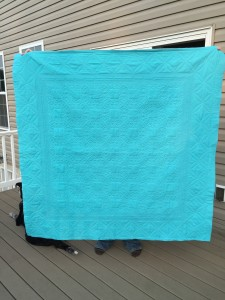 The back of the quilt to show off the long arm quilting!